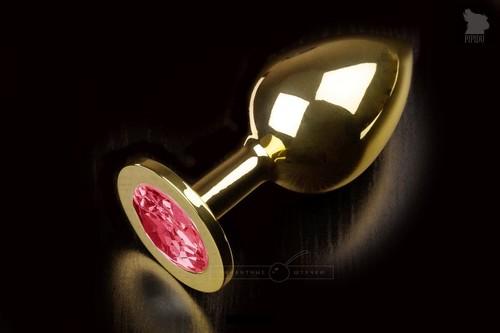Большая золотая анальная пробка с закругленным кончиком и рубиновым кристаллом - 9 см, цвет красный - Пикантные штучки
