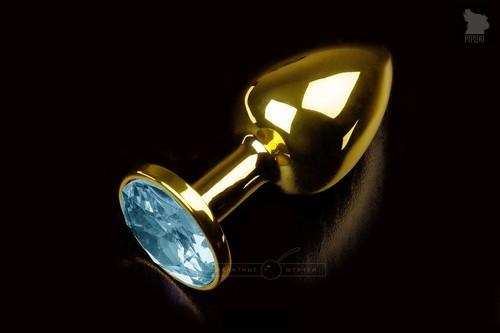 Маленькая золотистая анальная пробка с круглым кончиком и голубым кристаллом - 7 см, цвет голубой - Пикантные штучки