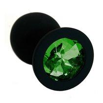 Чёрная силиконовая анальная пробка с изумрудным кристаллом - 7 см, цвет темно-зеленый/черный - Kanikule