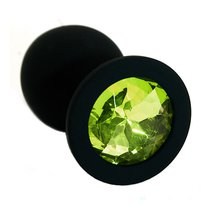 Чёрная силиконовая анальная пробка с светло-зеленым кристаллом - 7 см, цвет светло-зеленый/черный - Kanikule