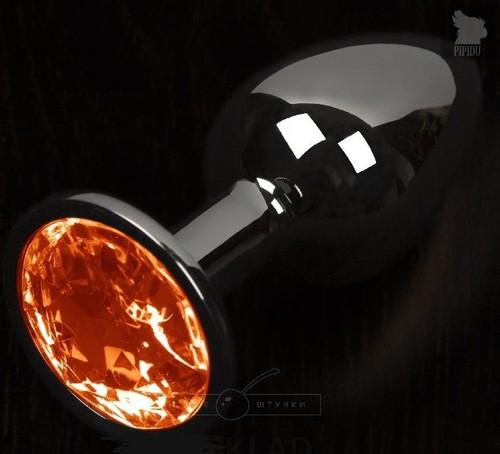 Графитовая анальная пробка с оранжевым кристаллом - 8,5 см., цвет оранжевый - Пикантные штучки